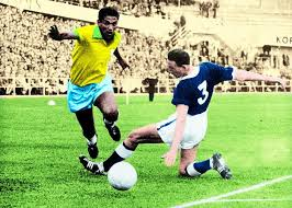 Garrincha in full flow for Brazil and beating his marker as always