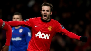 Juan Mata of Manchester United celebrates Robin van Persie scoring their first goal during the Barcl